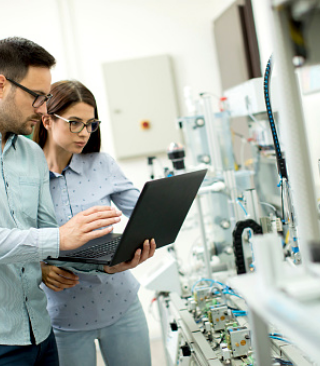two people in lab looking at computer
